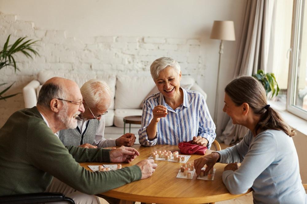 Senior people enjoying bingo game in nursing home